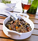 Provençal beef stew and a glass of red wine