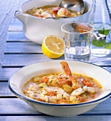 Greek fish soup in bowl and dish