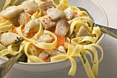 Ribbon pasta with tilapia and trout caviar in lemon sauce