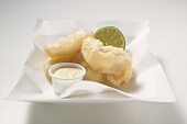 Tempura appetisers with lime mayonnaise on a square plate