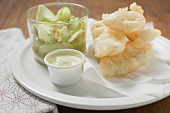 Tempura appetisers with mayonnaise & glass of cucumber salad