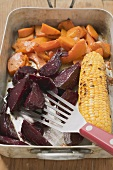 Oven-roasted beetroot, pumpkin and corn on the cob