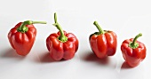 Four red peppers