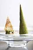 Quail terrine in the shape of a spire, beans in jelly