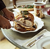 Stuffed roast pork being carved