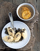 Semolina dumplings with stewed plums