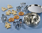 Marzipan ghosts and pumpkins with cutters for Halloween
