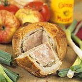 Pork pie, a piece cut (UK)