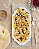 Warm chicory salad with orange segments and Roquefort