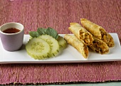 Spring rolls filled with vegetables, cucumber, chilli sauce