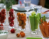 Vegetables in glasses with herb yoghurt dip