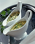 Tartar sauce and chive sauce in two sauce-boats