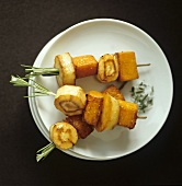 Baked sweet potato and parsnip on rosemary skewers