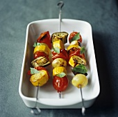 Three grilled vegetable kebabs (tomatoes, pepper, courgette)