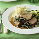 Roast lamb with spinach stuffing, cauliflower and peas