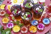 Iced tea with mint & rose petals, floral decorations outdoors