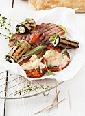 Grilled aubergine rolls and grilled tomato saltimbocca