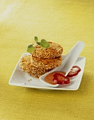Heidesand cookies with ham, sesame seeds & red pepper dip