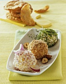 Onion, hazelnut & herb-coated cheese balls made with soft & 'hand' cheese