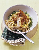 Guinea fowl breast on wholemeal spaghetti with lemon on cress