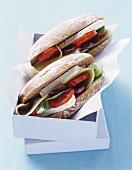 Feta, cucumber and tomato in Greek bread rolls to take away