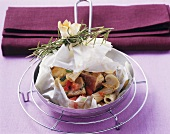 Tuna with spelt pasta and vegetables in parchment paper