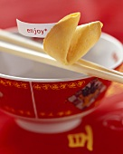 Asian bowl with chopsticks and fortune cookie