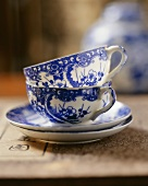 Two Chinese teacups and saucers