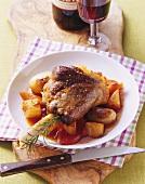 Mediterranean-style braised lamb shank on vegetables & potatoes