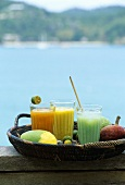 Three exotic fruit drinks out of doors