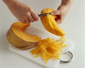 Making pumpkin ribbons with a vegetable peeler