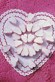 Heart-shaped marshmallows on a heart-shaped paper doily