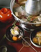 Hot pot with fish, meat, tofu and vegetables (Asia)