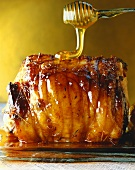Honey running onto roast pork