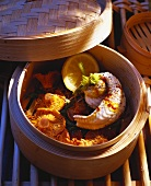 Sole roll with chanterelles cooked in a bamboo basket