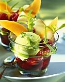 Herb sorbet on fruit in glasses