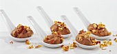 Quick chocolate cream with nut brittle on Asian spoons