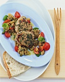 Medallions of veal with aubergine and tomato salad