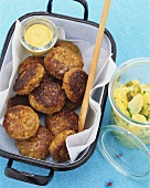 Meat patties with mustard and potato salad