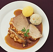 Roast pork with crackling and dumplings