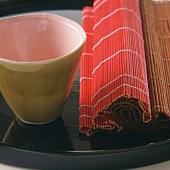 Raffia mats and beaker on tray