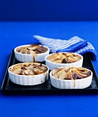 Small potato gratins in baking dishes