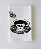 White paper napkin with printed design (cup of tea & biscuit)