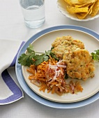 Crab cakes with carrot and radish salad
