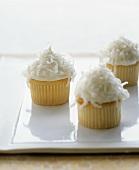 Three coconut cupcakes