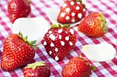 Strawberries with icing sugar dots
