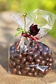 Chocolate beans in a cellophane bag