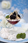 Meringue with blackberries and egg liqueur