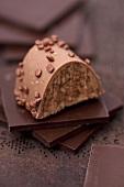 Nougat praline on squares of chocolate