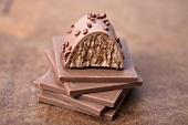 Nougat pralines on squares of chocolate